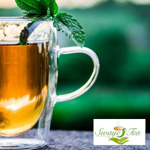 Photograph of glass cup with hot tea and mint leaves and Swaye Tea logo